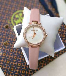 M K PARKER LEATHER ✔️US Grade  • Pearl dial with in rosegold hands • Crystal outer front case  • Rosegold high grade stainless case and lock • Push/pull crown  Comes with its complete orig inclusions: Paperbag, box, hardbox and manual