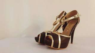Black and gold strapped heels