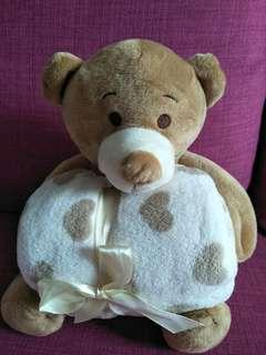 Teddy bear with blanket