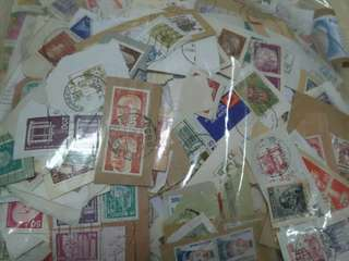 950 grams world wide used stamps collected by Germany charity used on paper kiloware