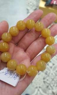 天然黃翡翠手鏈, 每粒13 mm,$800。
