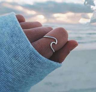 Wave-shaped ring