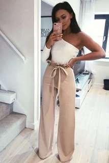 Nude trousers with tie around waist