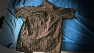 Brown flannel-like shirt.