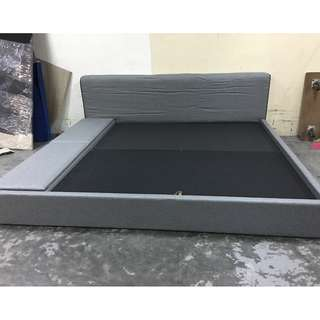 A new grey fabric king size bed with storage capability