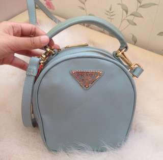 Authentic Prada Mini safiano bag with strap