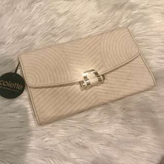 Colette cream stitching clutch brand new with tags