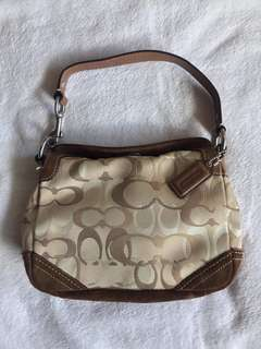 Pre-loved authentic Coach brown small carly