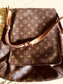 Authentic pre-loved Louis Vuitton -monogram GM musette salsa long