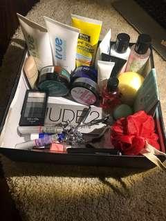Box of makeup, skincare etc