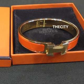BRAND NEW - AUTHENTIC HERMES CLIC CLAC BRACELET , IN ORANGE - SIZE M