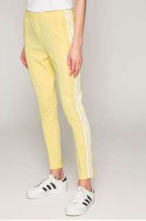 Track pants in pastel yellow