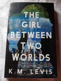 The Girl Between Two Worlds - K. M. Levis