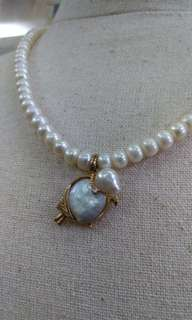 Real pearl necklace with quail pendant