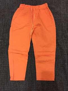 粉橘綁帶七分窄管褲