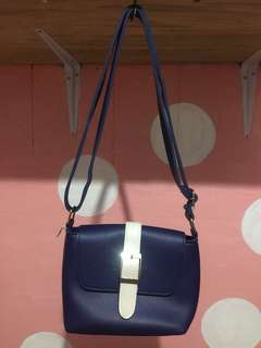 Small sling blue bag
