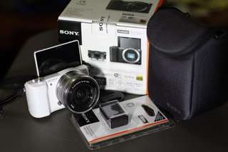 Sony A5100 (Alpha 5100 body, lens, extra battery, SD card and bag) w/ 1 year warranty