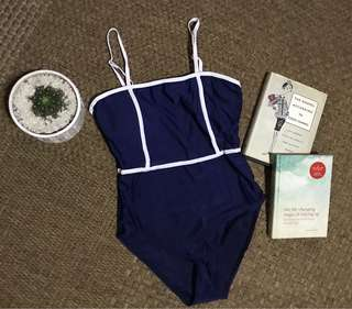 Simple blue swimsuit with white lining