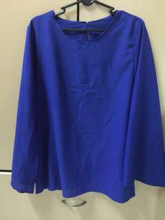 Blue blouse with long slit sleeve
