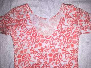 Scoop back top  color light printed orange (size small to medium)