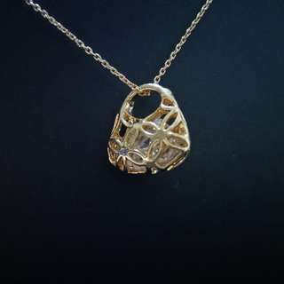 Gold basket with crystal necklace