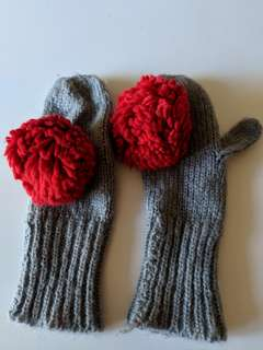 Mittens with red pom poms