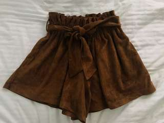 Camel-coloured flared shorts