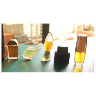 Five Miniature Perfume Bottles with perfume in them for a total of