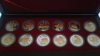Chinese Zodiac coins in wooden box