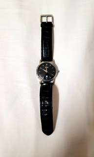 Preowned hugo boss watch, water resistant and stainless steel on a black leather band