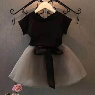 Black girl's top & grey skirt