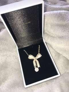 Karen walker bow necklace