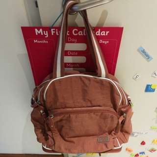 Diaper bag with sling / backpack function