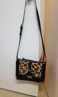 Leather and calf hair crossbody handbag