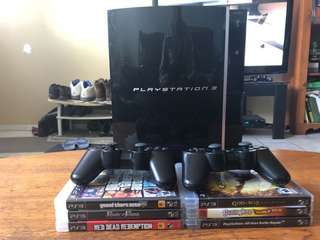 PlayStation 3 & 2 Controllers & 6 Games. Missing cords.