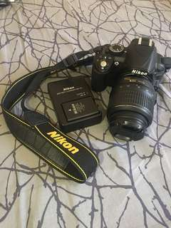 Nikon D3100 (with free tripod)