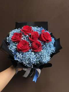 6 red roses and blue baby breath bouquet