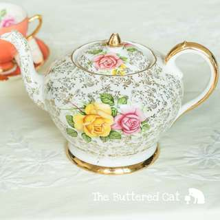 Beautiful vintage English bone china teapot, pink and yellow roses on chintz