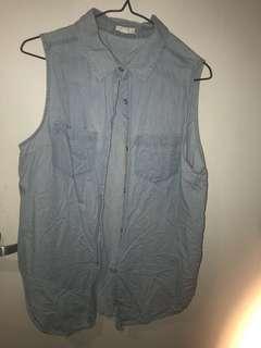 Sleeveless blue jean shirt