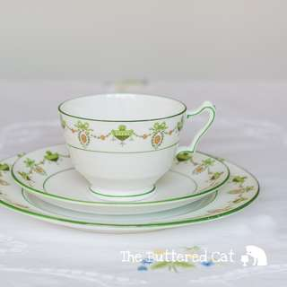 Antique early 1900s English bone china tea trio, ribbon bow, cameo garlands and swags