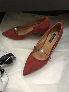 Wine red high heels with pearl decoration