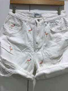 White denim shorts w/ flamingo design