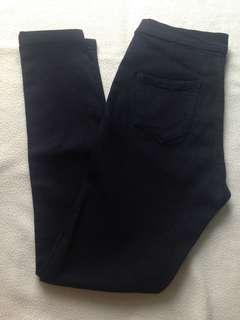 High-waisted black pants
