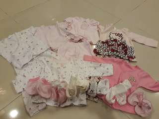 Bundle of baby clothes and booties