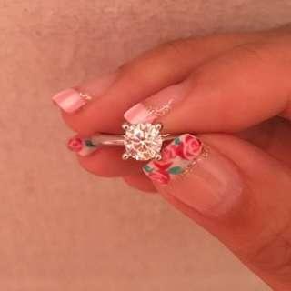 0.57 carat solitaire diamond ring
