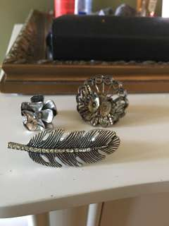 Feather, owl, and flower rings