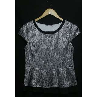 Peplum black and white formal top * small - med * never neen used and vwry pretty in actual.