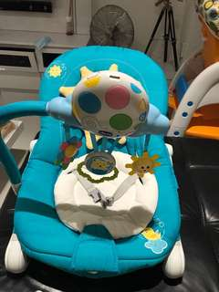Close to brand new CHICCO baby rocker with music and vibration