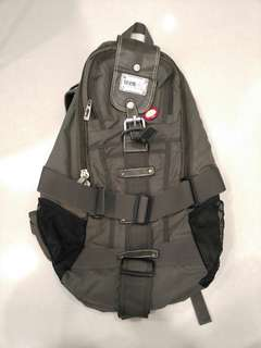 Used Teenmix olive green backpack