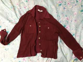 Red blouse with floral buttons